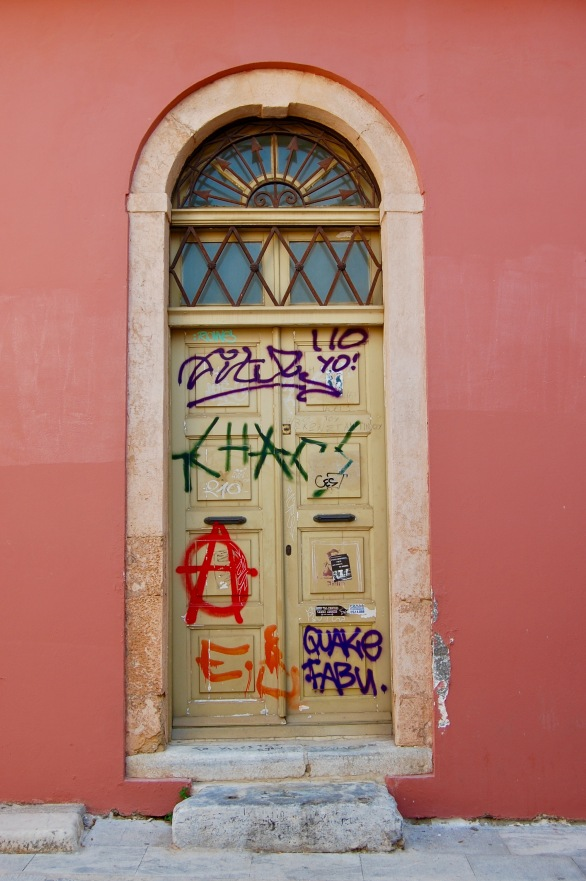 plaka-graffitied-door