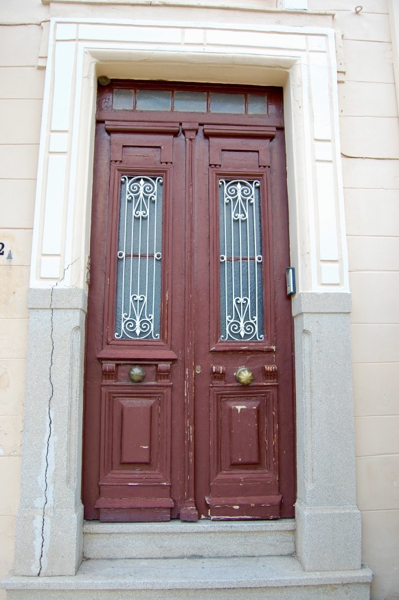 plaka-worn-brown-door