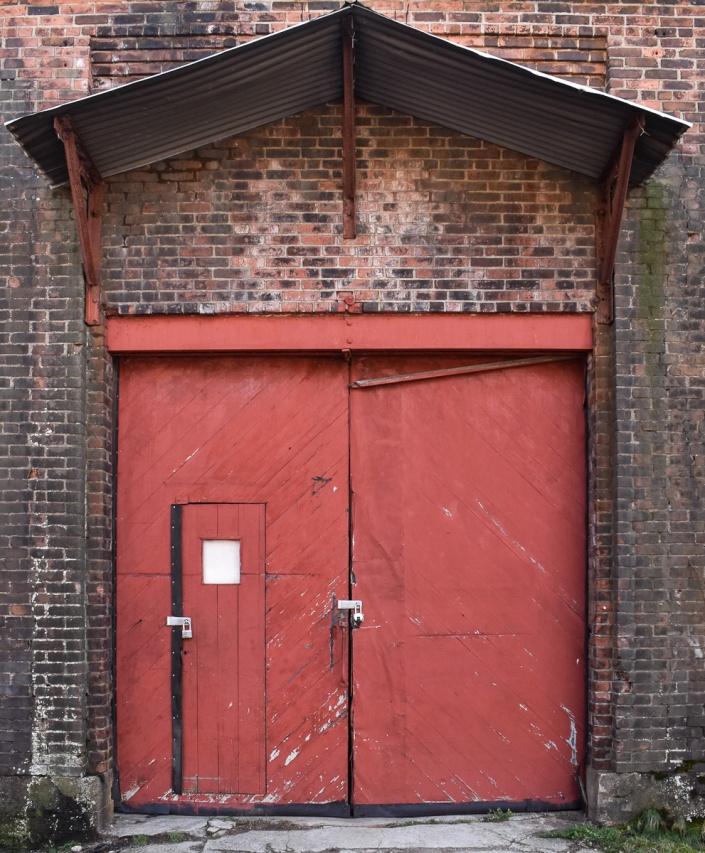 A small red door within a big red door.