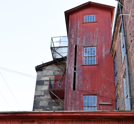 Look closely and you will see a red door next to the fire escape.