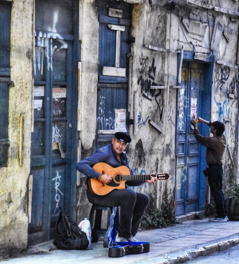 Street Musician and Blue Doors